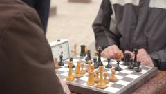 Playing chess on the street (close up) Day, chess, pensioner, old age Stock Footage