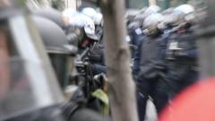 1080p 24fps - Heavily armed riot police officers with gas masks and horses - stock footage