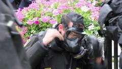 1080p 24fps - Riot police officers donning gas masks - HD 1080p - stock footage