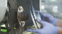 Mechanic installing a new brake disc Stock Footage