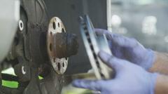 Mechanic installing a new brake disc - stock footage