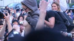1080p 24fps - Woman flashes her breasts at rioting crowd Stock Footage