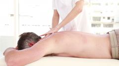 Man receiving back massage Stock Footage