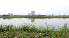 Tamsui river calm view from east side park Stock Footage