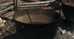 Sap boiling in old metal pots to produce maple syrup - stock footage