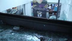 1080p 24fps - Broken mall window pan to left - HD 1080p Stock Footage