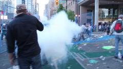 1080p 24fps - Gas bombs explodes right in front of camera in riot Stock Footage