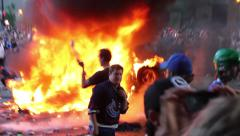 1080p 24fps - Hockey fans take pictures in front of burning car at riot Stock Footage