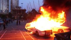 1080p 24fps - 2 cop cars burn while riot officers throw tear gas Stock Footage