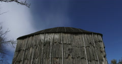 Iroquois longhouse in a reconstructed 15th century Iroquoian village in Canada Stock Footage