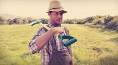 Happy farmer holding a shovel Stock Footage