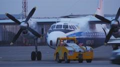Turbojet airplane Antonov AN-24RV during pushback at International Airport Kyiv Stock Footage