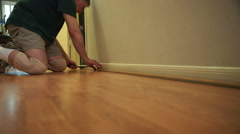 Ripping out shoe molding for laminate floor removal Stock Footage