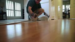 Handyman removing wood flooring Stock Footage