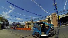 PUERTO PRINCESA - February 2015: Tricycles in town. Philippines Stock Footage