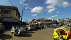 PUERTO PRINCESA - February 2015: Tricycles crossing junction. Philippines Stock Footage
