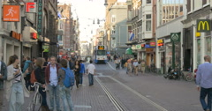 The Netherlands Amsterdam city Holland tramway tram busy street transport crowd Stock Footage