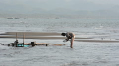 Man fishing along the malandog beach for milkfish frie in philippines Stock Footage