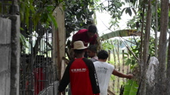 Filipinos building a wall Stock Footage