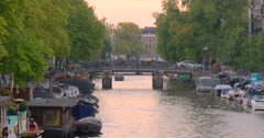 Netherlands Amsterdam city Holland canal canals boats living sun set sunset red Arkistovideo