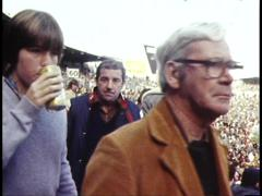 Stock Video Footage of ALCOHOL, FOOTBALL, SPECTATORS DRINK AT MATCH/POLICE