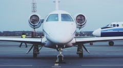 Front view of business jet and turbojet airplane Antonov AN-24RV being pushed Stock Footage