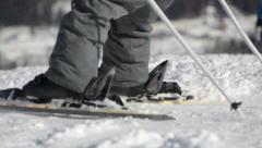 Snowboarders and skiers ride on the slope in ski resort Stock Footage