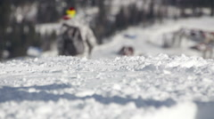 Skiers ride on the slope in ski resort - stock footage