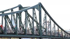 Pedestrians walking over an old iron bridge - stock footage