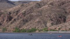 4K UHD slow zoom out looking up colorado river water sports and play Stock Footage