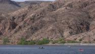 Stock Video Footage of 4K UHD slow zoom out looking up colorado river water sports and play