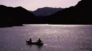 Stock Video Footage of 4K UHD two person canoe on the Colorado River silhouettes