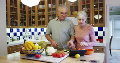 Stock Video Footage of Senior couple using tablet to learn new recipes