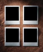 Polaroid style photo frames on vintage paper Stock Photos