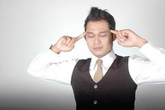 asian young man with posture was thinking - stock photo