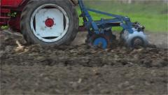 Tractor with harrows preparing a field for planting. Stock Footage