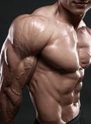 Muscled male model showing his biceps Stock Photos