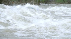Wild river rafting in huge waves crash into the boat super slow motion Stock Footage