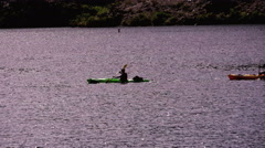 4K UHD kayakers paddle on the Colorado River traverse scene wide shot Stock Footage