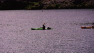 Stock Video Footage of 4K UHD kayakers paddle on the Colorado River traverse scene wide shot