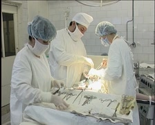 Two Surgeons And Nurse During Operation Stock Footage