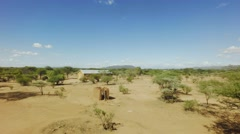 Church building in middle of vast african savannah landscape on hot day Stock Footage