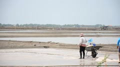 Salt farming or Salt evaporation pond - stock footage