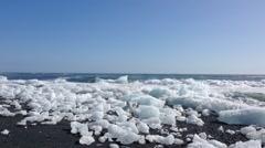 Iceberg on the beach close at the Jökulsárlón Glacier lagoon Stock Footage