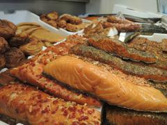 Stock Photo of Assorted selection of smoked fish in fish shop