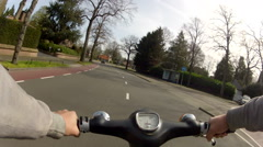 Driving oldtimer moped on sunny day Stock Footage