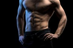 Portrait of handsome athlete topless at the studio - stock photo