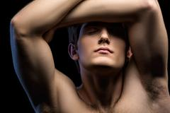 Close-up portrait of an attractive man with naked torso - stock photo