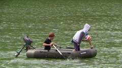 Teens swim in a motor boat on a mountain lake Mangup. Crimea. Stock Footage