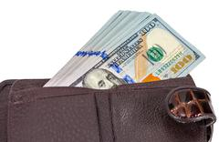 Wallet open with a dollar bill sticking out, isolated on white - stock photo